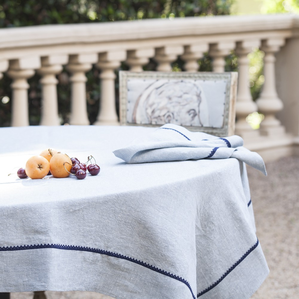 Agropoli Linen Tablecloth With Navy Border. Hover To Zoom